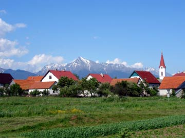 Mt. Kriváň is perhaps the most iconic peak in Slovakia's rugged High Tatra Mountains and is the site of traditional group ascents. The township of Pribylina sits in the foreground.